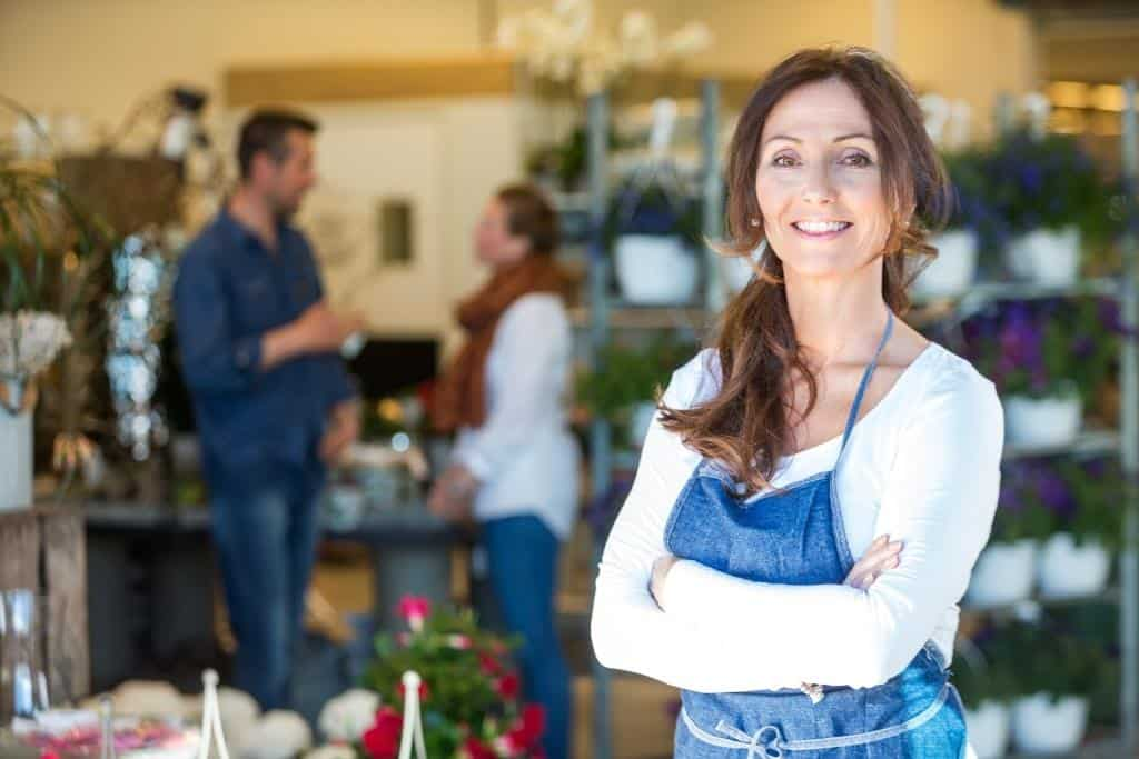 Portrait Of Smiling Florist At Flower Shop